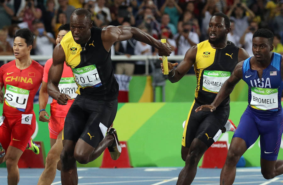 2016 Rio Olympics - Athletics - Final - Men's 4 x 100m Relay Final - Olympic Stadium - Rio de Janeiro, Brazil - 19/08/2016. Nickel Ashmeade (JAM) of Jamaica hands the baton over to teammate Usain Bolt (JAM). REUTERS/Phil Noble FOR EDITORIAL USE ONLY. NOT FOR SALE FOR MARKETING OR ADVERTISING CAMPAIGNS.